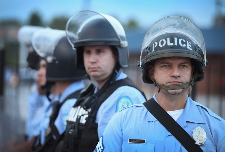 Police are deployed to keep peace along Florissant Avenue on August 16, 2014 in Ferguson, Missouri. Violent protests have erupted nearly every night along the street since the shooting death of teenager Michael Brown by a Ferguson police officer on August 9. (Photo by Scott Olson/Getty Images)