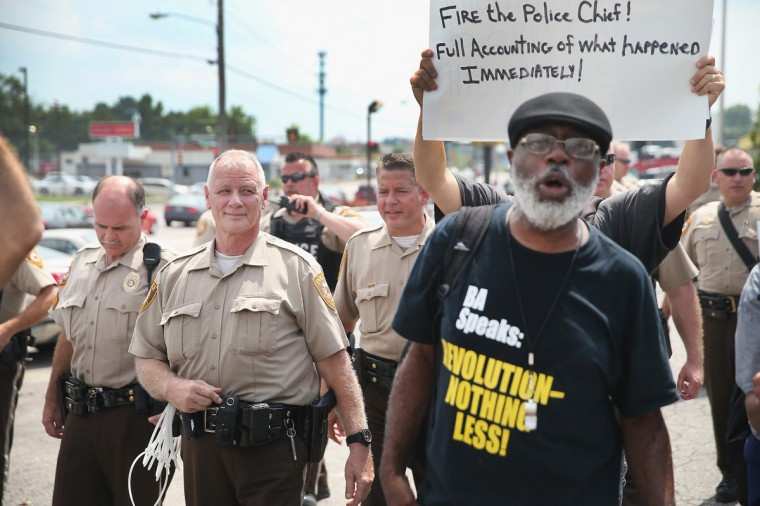Demonstrators continue to protest the killing of teenager Michael Brown on August 18, 2014 in Ferguson, Missouri. After a protest yesterday ended with a barrage of tear gas and gunfire, Missouri Governor Jay Nixon activated the national guard to help with security. Brown was shot and killed by a Ferguson police officer on August 9. Despite the Brown family's continued call for peaceful demonstrations, violent protests have erupted nearly every night in Ferguson since his death. (Photo by Scott Olson/Getty Images)