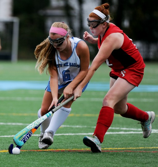 Mount de Sales' Allie Long, left, and Elizabeth Seton's Kaitlyn Steinbauer clash during a field hockey game at Mount de Sales Academy in Catonsville, Thursday, Sept. 25, 2014. (Jon Sham/BSMG)