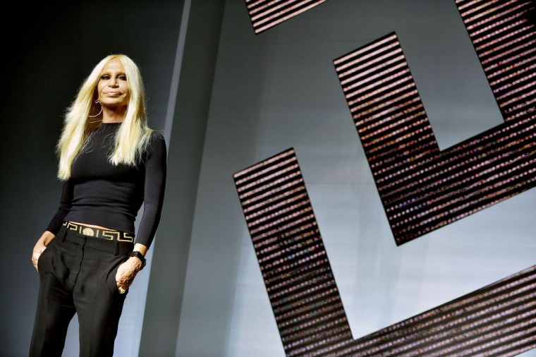 Italian designer Donatella Versace greets the audience at the end of her show during the 2015 Spring / Summer Milan Fashion Week on September 19, 2014 in Milan. (Tiziana Fabi/Getty Images)