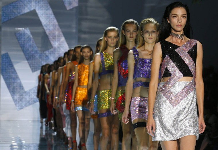 Models parade at the end of the Versace Spring/Summer 2015 collection during Milan Fashion Week September 19, 2014. (Stefano Rellandini/Reuters photo)
