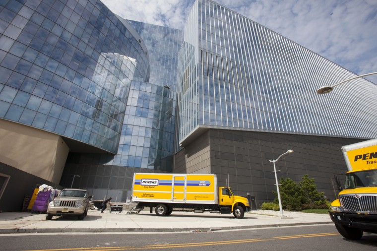 Moving trucks line up outside the Revel Casino on September 3, 2014 in Atlantic City, New Jersey. More than 5,000 employees at the Showboat and Revel Casinos lost their jobs as both places closed this weekend. Four of the twelve casinos with which Atlantic City started the year will have closed by the middle of September. That is putting almost 8,000 people total out of work. Trump Plaza is closing September 16, 2014, and the Atlantic Club shut down in January. (Photo by Jessica Kourkounis/Getty Images)