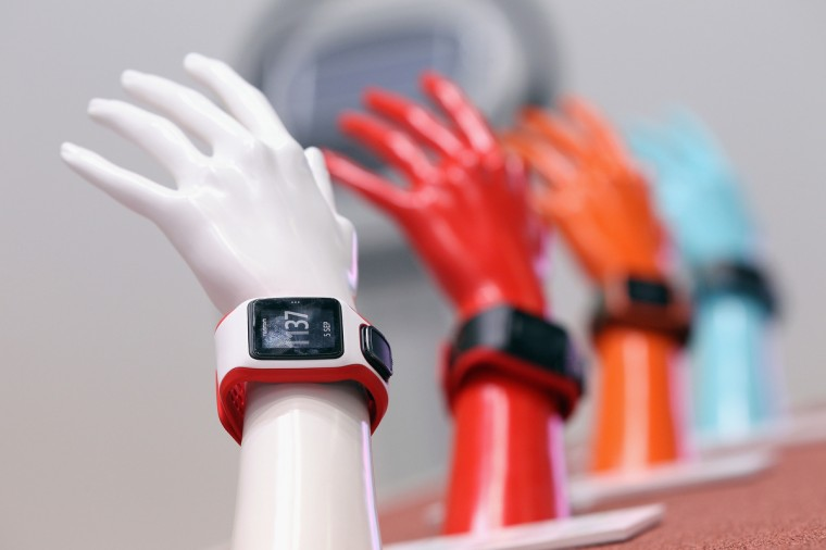 GPS-enabled Runner Cardio wrist devices lie on display at the Tomtom stand at the 2014 IFA home electronics and appliances trade fair on September 5, 2014 in Berlin, Germany. IFA is the world's biggest fair of its kind and is open to the public through September 10. (Sean Gallup/Getty Images)
