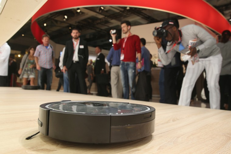 Visitors look at a Scout RX1 robotic vacuum cleaner at the Miele stand at the 2014 IFA home electronics and appliances trade fair on September 5, 2014 in Berlin, Germany. IFA is the world's biggest fair of its kind and is open to the public through September 10. (Sean Gallup/Getty Images)