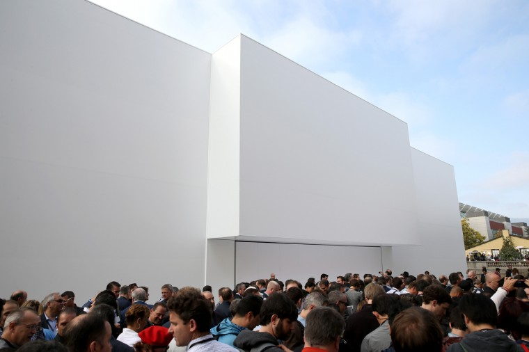 A crowd stands outside of a large white structure built ahead of the Apple keynote at the Flint Center for the Performing Arts at De Anza College on September 9, 2014 in Cupertino, California. Apple is expected to reveal both the iPhone 6 and their long-rumored wearable smartwatch device. Justin Sullivan/Getty Images