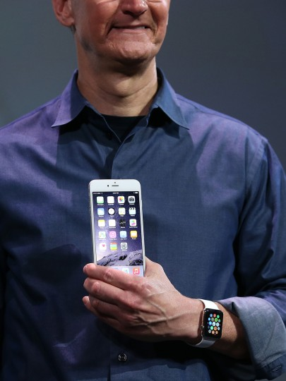 Apple CEO Tim Cook shows off the new iPhone 6 and the Apple Watch during an Apple special event at the Flint Center for the Performing Arts on September 9, 2014 in Cupertino, California. Apple is expected to unveil the new iPhone 6 and wearble tech. Justin Sullivan/Getty Images