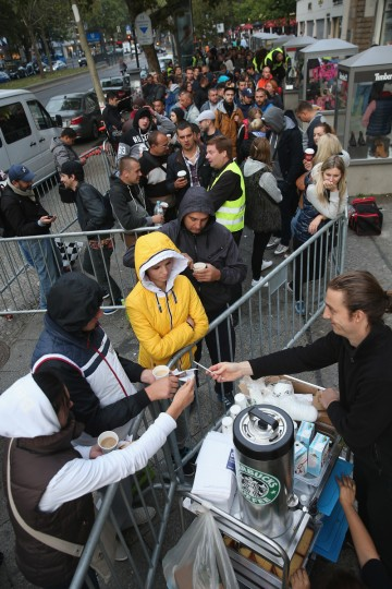 People buy coffee as they wait to enter the Apple Store at 8am on the first day of sales of the new Apple iPhone 6 in Germany on September 19, 2014 in Berlin, Germany. Hundreds of people had waited in a line that went around the block through the night in order to be among the first people to buy the new smartphone, which comes in two versions: the Apple iPhone 6 and the somewhat larger Apple iPhone 6 Plus. Sean Gallup/Getty Images