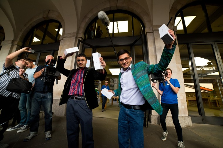 Jamael Ahmed and Sam Sheikh leave the store after being the first to purchase the iPhone 6 at the Apple Covent Gardens launch on September 19, 2014 in London, England. Ben A. Pruchnie/Getty Images