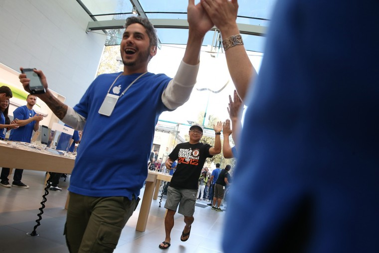 Apple Store employees greet customers as they arrive to purchase the new iPhone 6 on September 19, 2014 in Palo Alto, California. Justin Sullivan/Getty Images