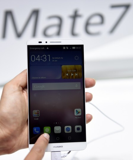 """A Ascend Mate 7 smartphone is displayed at the booth of Chinese multinational networking and telecommunications company Huawei on the opening day of the consumer electronics trade fair """"Internationale Funk Ausstellung """"(IFA) in Berlin. (Tobias Schwarz/AFP/Getty Images)"""