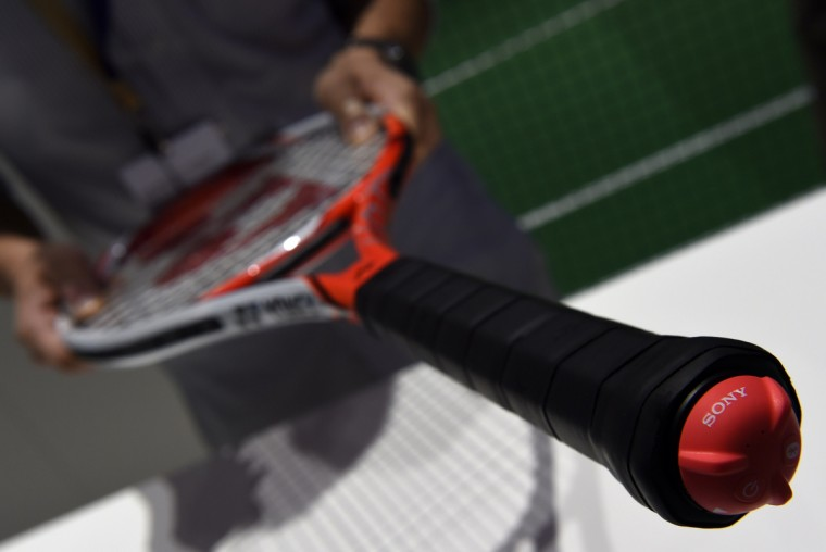 """The Smart Tennis Sensor linking a tennis racket to a smartphone is displayed at the booth of Japanese giant Sony on the opening day of the consumer electronics trade fair """"Internationale Funk Ausstellung """"(IFA) in Berlin September 5, 2014. IFA, one of Europe's biggest showcases of the latest electronic gadgets runs until September 10, 2014. (Tobias Schwarz/AFP/Getty Images)"""