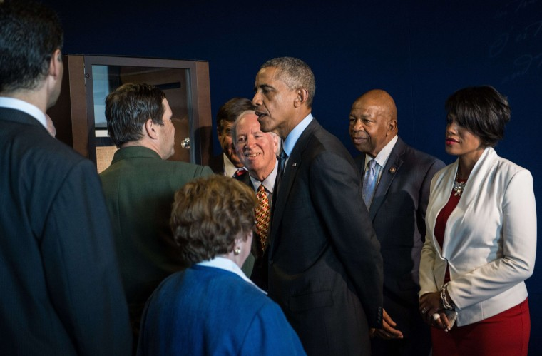 US President Barack Obama listens to explanations as he views the manuscript of the Star Spangled Banner while touring Fort McHenry in Baltimore, Maryland, on September 12, 2014. Fort McHenry is best known for its successful defense of Baltimore Harbor from the British navy on September 1314, 1814. (Nicholas Kamm/AFP/Getty Images)