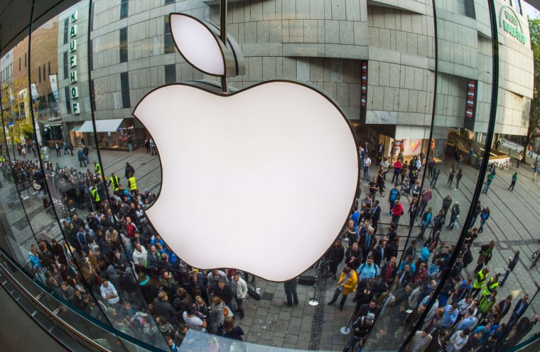 People crowd in front of the Apple Store in Munich, southern Germany, on September 19, 2014 to purchase a new Apple Iphone 6 mobile device. Apple said earlier this week that it had received record pre-orders for its new iPhone models, and that some customers will have to wait for the larger-screen versions of the smartphones. Peter Kneffel/AFP/Getty Images