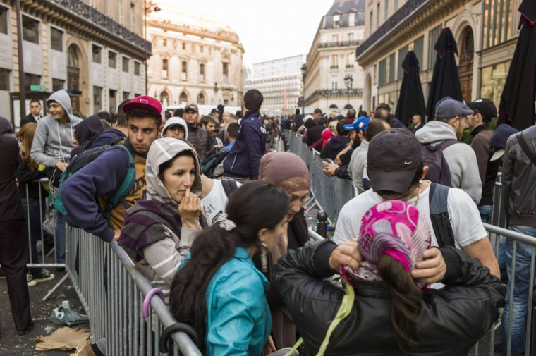 People wait in front of the Apple Store in Paris to buy the latest iPhone, the iPhone 6, on September 19, 2014 in Paris. Apple says more than four million pre-orders were received in the 24 hours after the sale was announced. Other markets launching on September 19 are Singapore, Britain, France, Germany, the United States, Canada and Puerto Rico. Some 20 more countries will get the new iPhone from September 26. Fred Dufour/AFP/Getty images