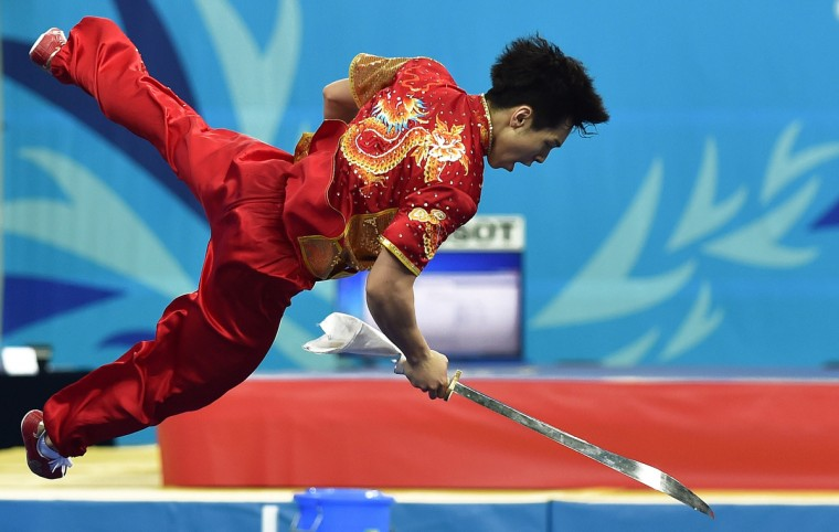 Lee Yong-hyun of South Korea performs during the wushu final men's daoshu at the 2014 Asian Games in Incheon. (Bay Ismoyo/Getty Images)