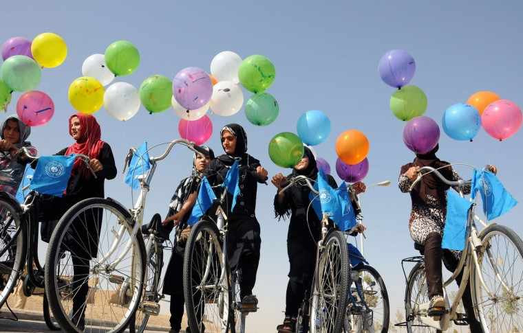 Afghan residents take part in cycling race during World Peace Day in Mazar-i-sharif. Each year the International Day of Peace is observed around the world on 21 September. The General Assembly has declared this as a day devoted to strengthening the ideals of peace, both within and among all nations and peoples. (Farshad Usyan/Getty Images)