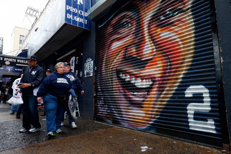 Fans walk past a mural of Derek Jeter #2 of the New Yankees painted outside of Yankee Stadium prior to his last game there on September 25, 2014 the Bronx borough of New York City. (Mike Stobe/Getty Images)