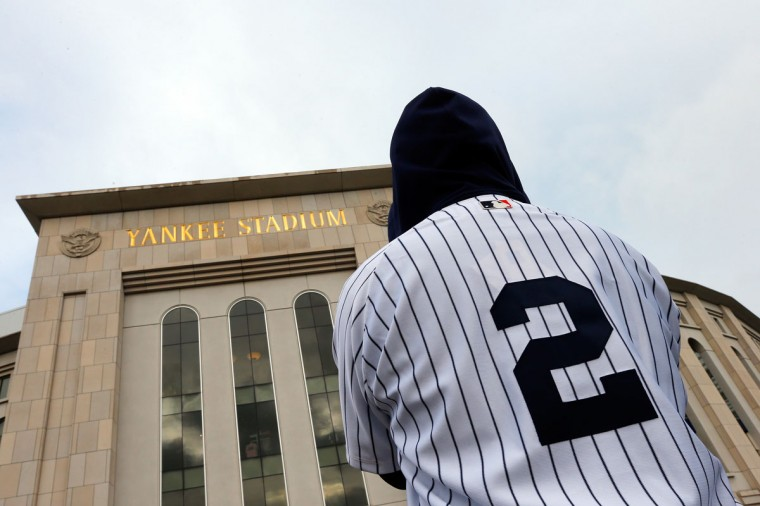 A fan wearing a Derek Jeter jersey stands outside of Yankee Stadium prior to his last game there on September 25, 2014 the Bronx borough of New York City. (Mike Stobe/Getty Images)