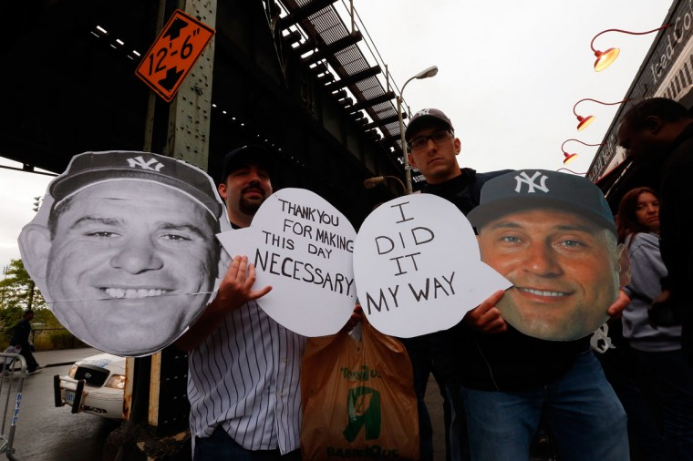 Fans hold signs outside of Yankee Stadium prior to Derek Jeter's last game there on September 25, 2014 the Bronx borough of New York City. (Mike Stobe/Getty Images)