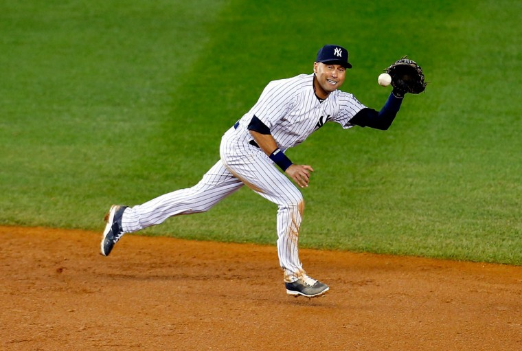 Derek Jeter #2 of the New York Yankees fields a ball against Baltimore Orioles in his last game ever at Yankee Stadium on September 25, 2014 in the Bronx borough of New York City. (Mike Stobe/Getty Images)