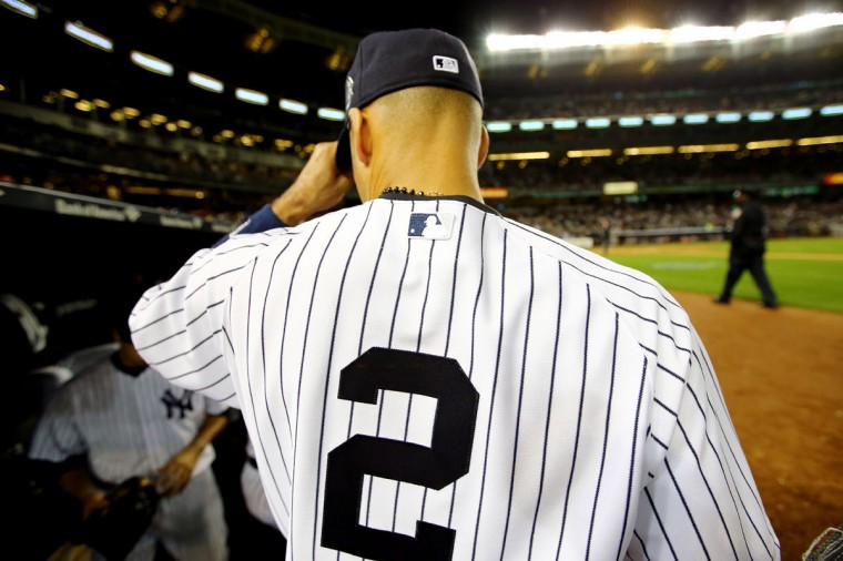 Derek Jeter #2 of the New York Yankees looks on from the dugout against the Baltimore Orioles in his last game ever at Yankee Stadium on September 25, 2014 in the Bronx borough of New York City. (Al Bello/Getty Images)
