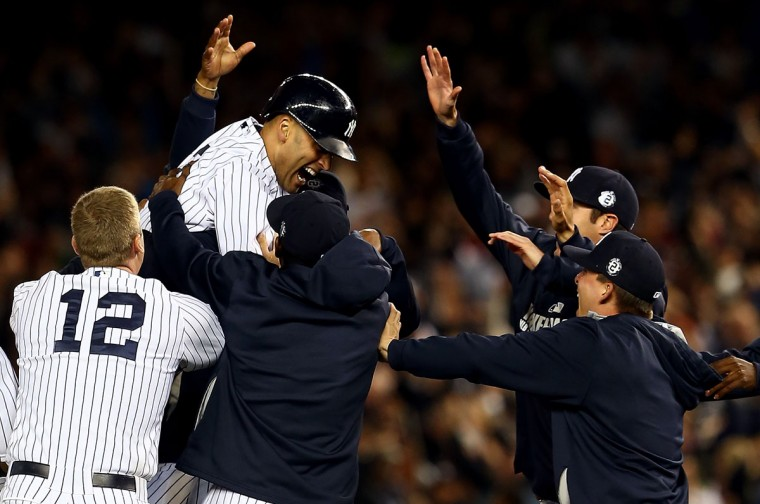 Derek Jeter #2 of the New York Yankees celebrates with his team after a game winning RBI hit in the ninth inning against the Baltimore Orioles in his last game ever at Yankee Stadium on September 25, 2014 in the Bronx borough of New York City. (Elsa/Getty Images)