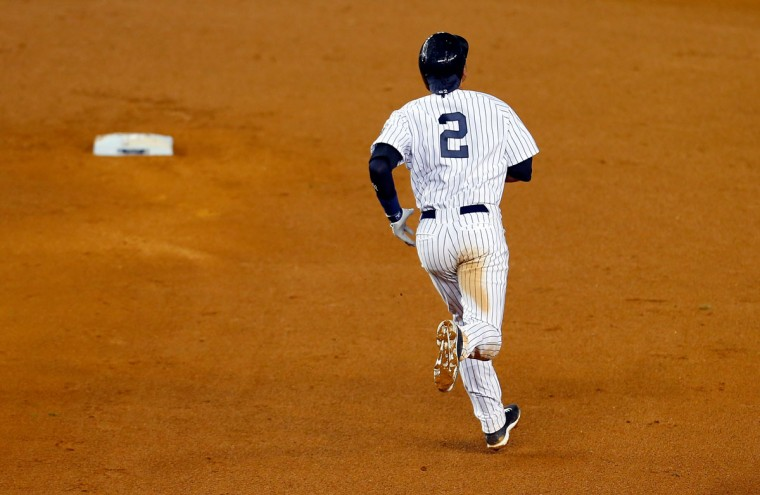 Derek Jeter #2 of the New York Yankees runs to second base against the Baltimore Orioles during a game at Yankee Stadium on September 25, 2014 in the Bronx borough of New York City. (Mike Stobe/Getty Images)