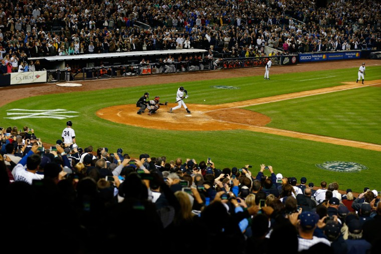 Derek Jeter #2 of the New York Yankees hits a game winning RBI hit in the ninth inning against the Baltimore Orioles in his last game ever at Yankee Stadium on September 25, 2014 in the Bronx borough of New York City. (Mike Stobe/Getty Images)