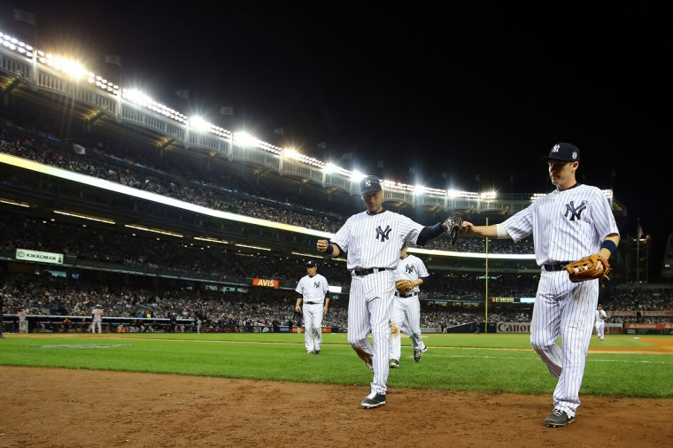 Derek Jeter #2 of the New York Yankees walks into the dugout against the Baltimore Orioles at Yankee Stadium on September 25, 2014 in the Bronx borough of New York City. (Al Bello/Getty Images)