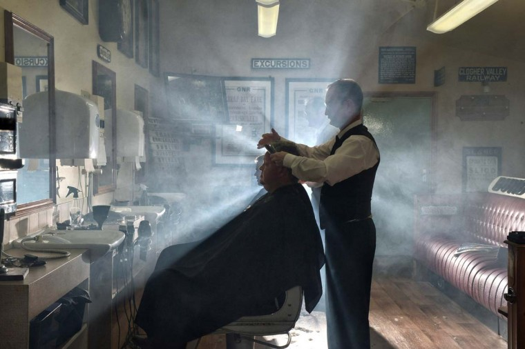 A customer of the Headhunters Barber Shop and Railway Museum gets a hair and from station master Nigel Johnston on September 29, 2014 in Enniskillen, Northern Ireland. Established in 2002, with the help of former railway employees and enthusiasts, the museum is run by three brothers, Selwyn, Nigel and Gordon Johnston whose purpose whilst operating a busy hairdressing service from within the museum is to collect, preserve, and interpret local railway heritage for the benefit of the community. Visitors and customers both start their journey at the reconstructed Railway Booking Office where the ticket collector invites you to step on board and enjoy the evocative nostalgia and artefacts associated with the railways which operated throughout Fermanagh and the Border Counties until their closure in 1957. (Charles McQuillan/Getty Images)