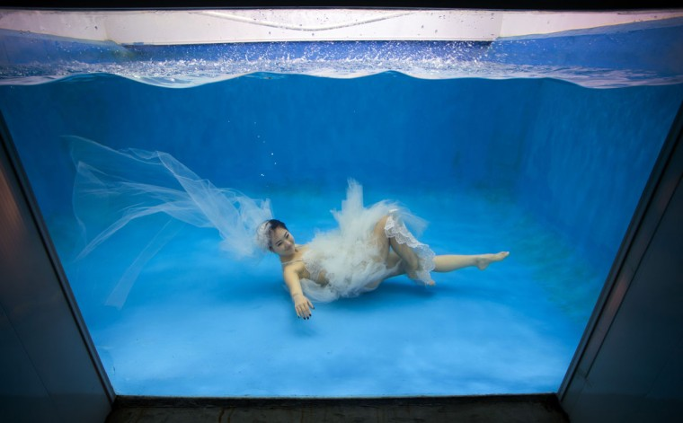 Leng Yuting, 26, posing underwater for her wedding pictures at a photo studio in Shanghai, ahead of her wedding next year. (Johannes Eisele/AFP/Getty Images)
