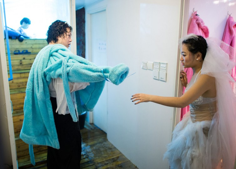 Qin Riyang (R) and Leng Yuting, both 26 years old, drying off after their underwater photoshoot at a studio in Shanghai, ahead of their wedding next year. (Johannes Eisele/AFP/Getty Images)