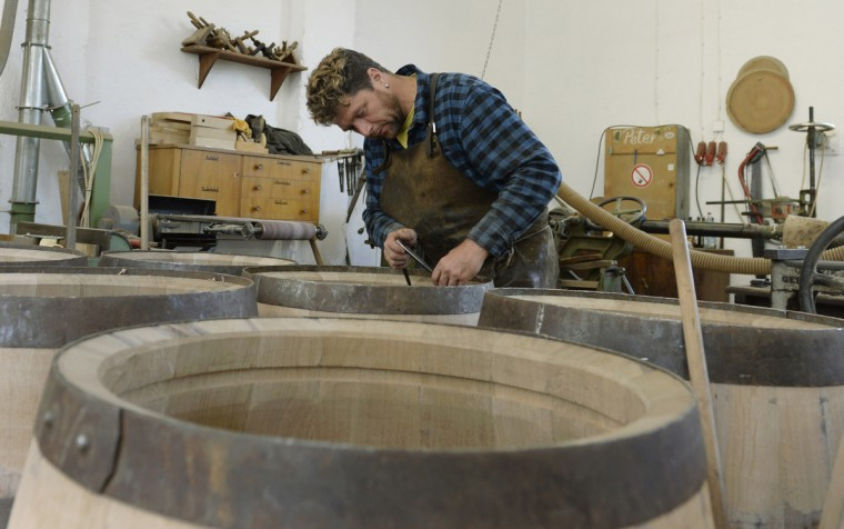 Cooper Peter Silva produces beer barrels made of oak wood at the barrel factory Schmid in Munich, southern Germany, on September 8, 2014. The barrel factory produces about 1,000 beer barrels with capacities of ten to 200 liters per year. (Christof Stache/AFP/Getty Images)