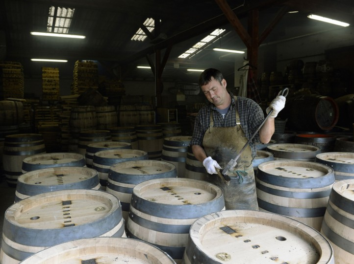 Cooper Joerg Schnepper prepares new beer barrels made of oak wood for the burning of the signature at the barrel factory Schmid in Munich, southern Germany, on September 8, 2014. The barrel factory produces about 1,000 beer barrels with capacities of ten to 200 liters per year. (Christof Stache/AFP/Getty Images)