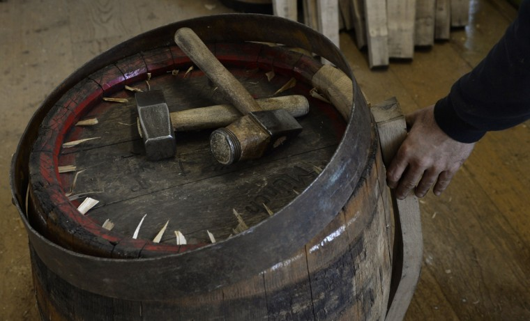 Tools lay on an old beer barrel to be refurbished at the barrel factory Schmid in Munich, southern Germany, on September 8, 2014. The barrel factory produces about 1,000 beer barrels with capacities of ten to 200 liters per year. (Christof Stache/AFP/Getty Images)