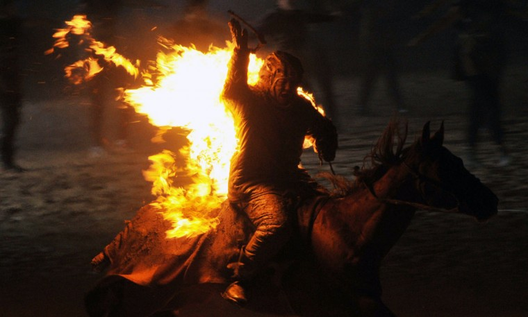 A Kyrgyz stuntman performs during the opening ceremony of the first World Nomad Games at the hippodrome of Cholpon-Ata, some 270 kms outside the capital Bishkek, on September 9, 2014. (Vyacheslav Oseledkov/AFP/Getty Images)