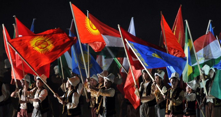 Participants wave flags of the countries competing in the first World Nomad Games during the opening ceremony at the hippodrome of Cholpon-Ata, some 270 kms outside the capital Bishkek, on September 9, 2014. (Vyacheslav Oseledkov/AFP/Getty Images)