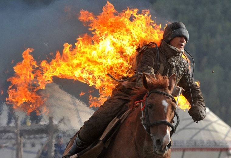 A Kyrgyz stuntman performing during the first World Nomad Games in the Kyrchin (Semenovskoe) gorge, some 300 km from Bishkek. (Vyacheslav Oseledkov/AFP/Getty Images)