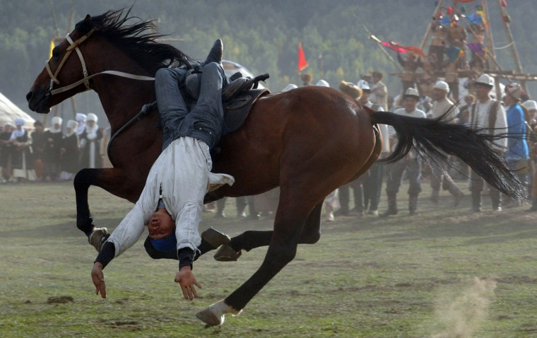 A Kyrgyz rider performing during the first World Nomad Games in the Kyrchin (Semenovskoe) gorge, some 300 km from Bishkek. (Vyacheslav Oseledkov/AFP/Getty Images)