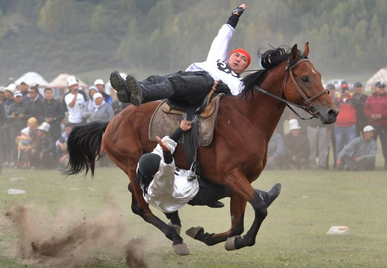 Kyrgyz riders perform during the first World Nomad Games in the Kyrchin (Semenovskoe) gorge, some 300 km from Bishkek on September 11, 2014. (Vyacheslav Oseledkov/AFP/Getty Images)