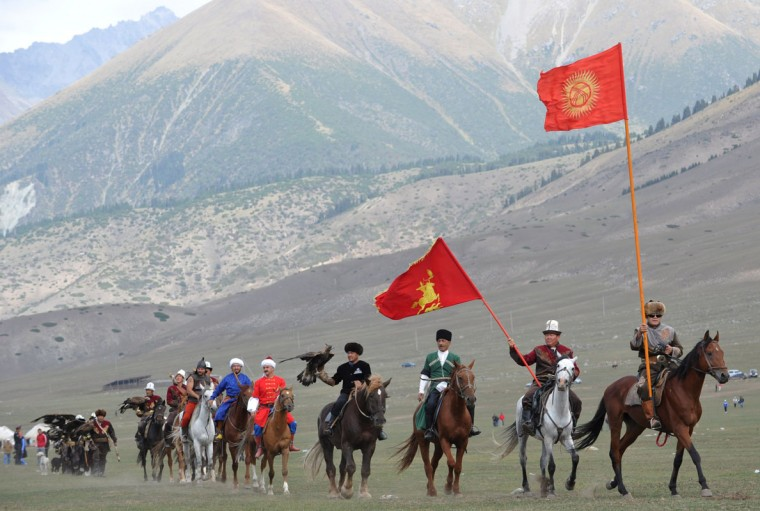 Riders carry flags during the first World Nomad Games in the Kyrchin (Semenovskoe) gorge, some 300 km from Bishkek on September 11, 2014 . (Vyacheslav Oseledkov/AFP/Getty Images)