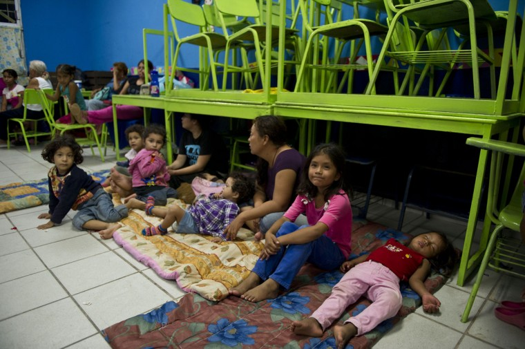 People gather in a shelter in Cabo San Lucas, Baja California State, Mexico, on September 14, 2014. Hurricane Odile swirled menacingly toward Mexico's Los Cabos resorts on Sunday, forcing authorities to evacuate high-risk areas and open shelters as the powerful storm threatened to thrash the Pacific coast. (Donaldo Schemidt/AFP/Getty Images)