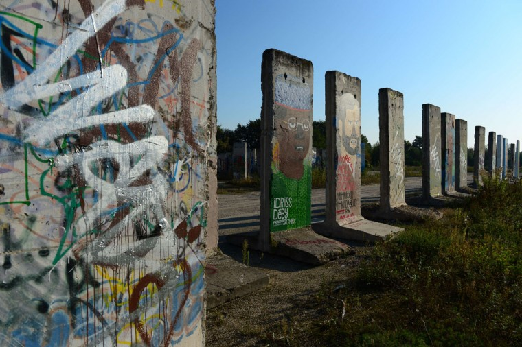 "Cement slabs that used to make up the Berlin wall stand in a vacant lot in Teltow outside of Berlin on September 18, 2014. East Germany's rulers threw up the Berlin Wall in August 1961 to halt a mass exodus of disgruntled citizens turning their backs on the ""workers' paradise"". (Photos by John MacDougall/AFP/Getty Images)"