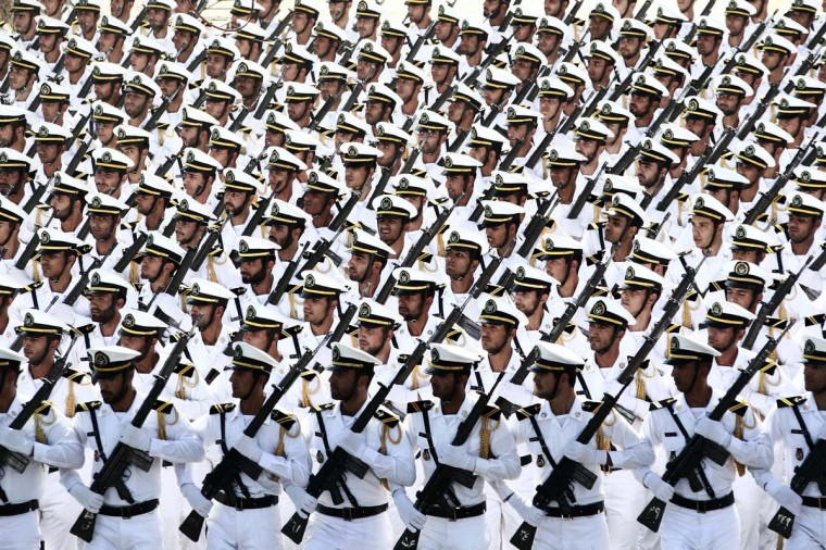 "Iranian Naval troops march during the annual military parade marking the anniversary of Iran's war with Iraq (1980-88) in Tehran, on September 22, 2014. Iran is a cornerstone of stability in the Middle East in the face of the ""terrorists"" rocking the region, President Hassan Rouhani said before leaving for the United Nations. (Behrouz Mehri/AFP/Getty Images)"