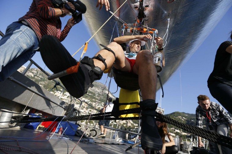 "French adventurer and researcher Stephane Rousson prepares his ""Aerosail"" on September 28, 2014, in Roquebrune-Cap-Martin, southeastern France prior to his planned attempt to cross the Mediterranean from Nice to Calvi, on the French Mediterraean island of Corsica. (VALERY HACHE/AFP/Getty Images)"