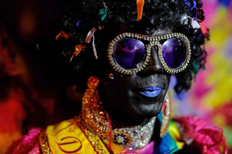A reveller takes part in the 2nd LGBT Pride Parade at Alemao favela in Rio de Janeiro, Brazil, on September 28, 2014. The annual parade aims for long-term actions to minimize prejudice and violences against the Lesbian, Gay, Bisexual, Transvestite and Transsexual community. (Yasuyoshi ChibayaAFP/Getty Images)