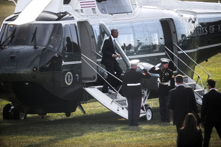 President Barack Obama exits his helicopter after landing at Sun Park this afternoon. (Barbara Haddock Taylor/Baltimore Sun)