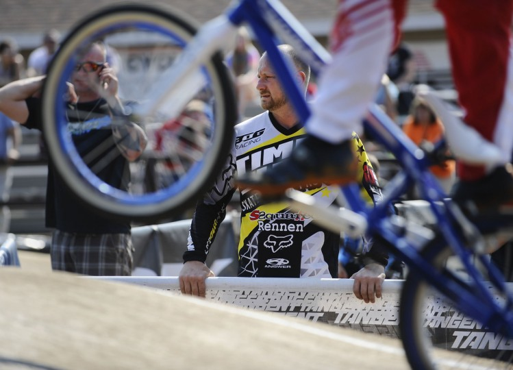 Timm Raum, of Clear Spring, watches bikers practice during the Quaker State National races in Pottstown, PA. Rachel Woolf/Baltimore Sun