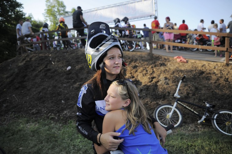 From left, Ashton Raum, 19, is hugged by her sister Lilly Raum, 11, both of Clear Spring, after losing her final race on Saturday. Ashton received last place in the 17-20 girls class and chose to lose over risking a crash during the Quaker State National races in Pottstown, PA. Rachel Woolf/Baltimore Sun