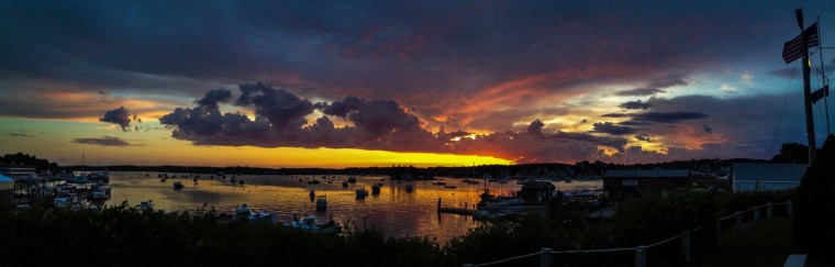 A sunset filled with all hues stopped people in their tracks above Boothbay Harbor, Maine, in a panoramic image taken with a smartphone. (Karl Merton Ferron/Baltimore Sun)